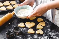 Cooking homemade cookies with hands on dark background Royalty Free Stock Image