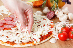 Cooking homemade traditional Italian delicious pizza four seasons Stock Image