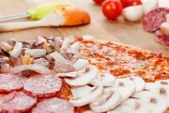 Cooking homemade traditional Italian delicious pizza four seasons Stock Photos