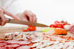 Cooking homemade traditional Italian delicious pizza four seasons Royalty Free Stock Photography