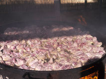 Cooking a huge pan of Paella on the Burriana Beach in Nerja Andalucia Spain Royalty Free Stock Photo