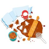 Cooking and icing ginger cookies. stock photos