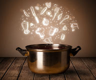 Cooking icons coming out from cooking pot Royalty Free Stock Image