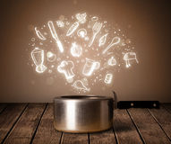 Cooking icons coming out from cooking pot. Shiny cooking icons coming out from cooking pot Stock Image