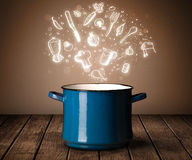 Cooking icons coming out from cooking pot Stock Photo