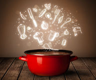 Cooking icons coming out from cooking pot Royalty Free Stock Photography
