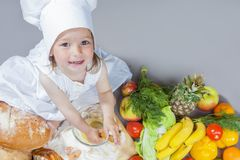 Cooking Ideas. Caucasian Little Girl In Cook Uniform Royalty Free Stock Images