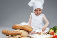 Cooking Ideas and Concepts. Portrait of Little Caucasian Girl in Stock Photos