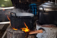 Cooking. Indigenous cooking, cook rice by burning wood Stock Images