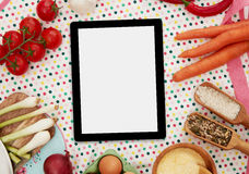 Cooking ingredients and digital tablet Royalty Free Stock Image
