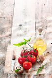 Cooking ingredients in grungy kitchen. Fresh cooking ingredients in a grungy kitchen on an old vintage wooden table Royalty Free Stock Photo