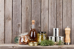 Cooking ingredients, herbs and spices on shelf stock image
