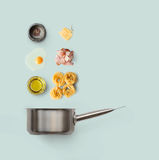 Cooking ingredients for italian food, carbonara, isolated on blue background Stock Photography