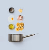 Cooking ingredients for italian food, carbonara, isolated on blue background Royalty Free Stock Photos