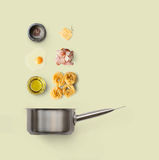 Cooking ingredients for italian food, carbonara, isolated on yellow background Royalty Free Stock Photos