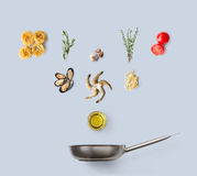 Cooking ingredients for italian food, seafood pasta, isolated on blue Stock Photo