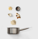 Cooking ingredients for italian risotto with wild mushrooms. Cooking italian food, risotto with wild mushrooms,  on white background. Rice, fungus, sauce Stock Photography