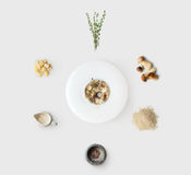 Cooking ingredients for italian risotto with wild mushrooms isolated. Cooking italian food, risotto with wild mushrooms, isolated on white background. Rice Royalty Free Stock Image