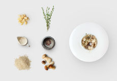 Cooking ingredients for italian risotto with wild mushrooms isolated. Cooking italian food, risotto with wild mushrooms, isolated on white background. Rice Royalty Free Stock Photography