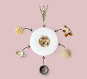 Cooking ingredients for italian risotto with wild mushrooms isolated on yellow. Risotto with wild mushrooms ingredients flat lay, isolated on pink background Royalty Free Stock Photo