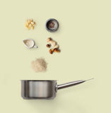Cooking ingredients for italian risotto with wild mushrooms  on yellow. Cooking italian food, risotto with wild mushrooms,  on yellow background. Rice, fungus Royalty Free Stock Photos