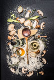 Cooking Ingredients for mushrooms risotto on dark background, top view. Royalty Free Stock Image