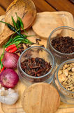 Cooking ingredients. Spice and herbs with onion and garlic on wooden board Royalty Free Stock Photography