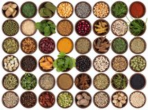Cooking ingredients to add flavor and seasoning. Selection of cooking ingredients to add flavor and seasoning. Spices, herbs, seeds and pulses Royalty Free Stock Photography