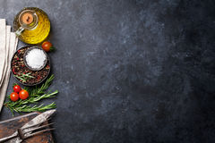 Cooking ingredients and utensils on stone table Royalty Free Stock Photo