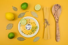 Cooking ingredients on yellow background royalty free stock photography