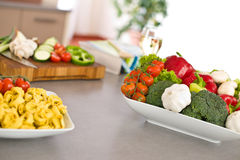 Cooking Italian food - pasta, tomato and vegetable Royalty Free Stock Photo