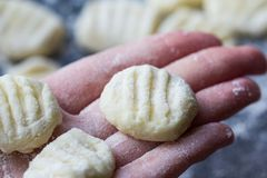 Cooking Italian homemade potato gnocchi fork Royalty Free Stock Images