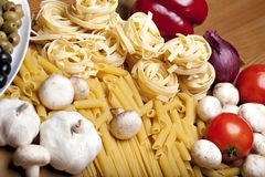 Cooking with italian ingredients Royalty Free Stock Photography