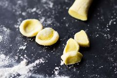 Cooking Italian pasta orecchiette, yellow dough, home Stock Image