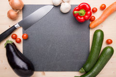 Cooking items. On a plate of slate stock photography
