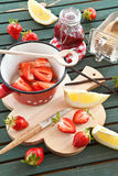 Cooking jam with fresh strawberries Royalty Free Stock Image