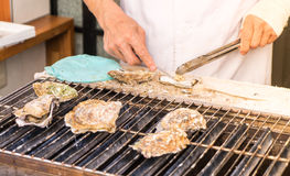 Cooking Japanese grilled Oysters Stock Photo