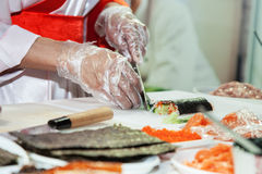 Cooking japanese sushi rolls Stock Photos