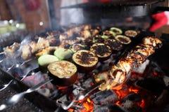 Cooking of kebab on skewers Stock Images
