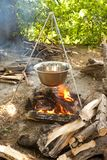 Cooking in kettle. On tripod , wood is ready Royalty Free Stock Image