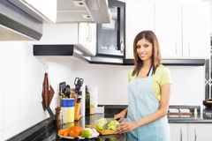 Cooking in kitchen Royalty Free Stock Images
