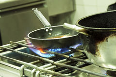 Cooking in a kitchen stock images
