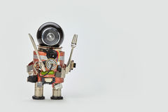 Cooking kitchen chef character with fork and knife in arms. Food menu concept with friendly robot, black helmet electric Royalty Free Stock Images
