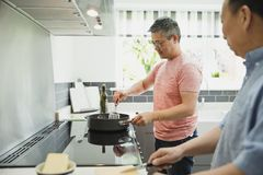 Cooking in the Kitchen with Dad royalty free stock photography