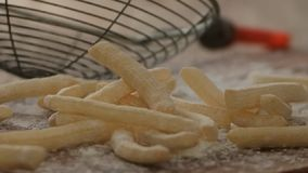 French fries with flour. Cooking in kitchen flour and french fries stock footage