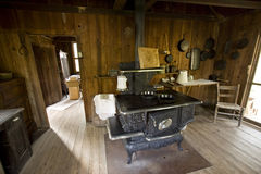 Cooking in the kitchen. A old fashioned kitchen with old stove Stock Images