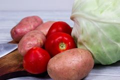 Kitchen, cooking, potato, knife, cutting board Royalty Free Stock Photography