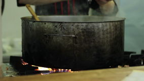 Cooking in a Large Pan stock video footage