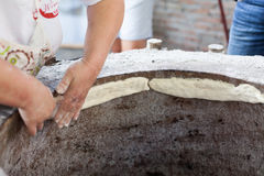 Cooking lavash in the tandoor stock photo