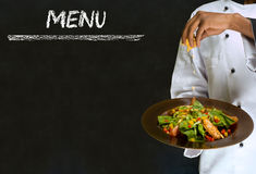 Chef with healthy salad food on chalk blackboard m Royalty Free Stock Images